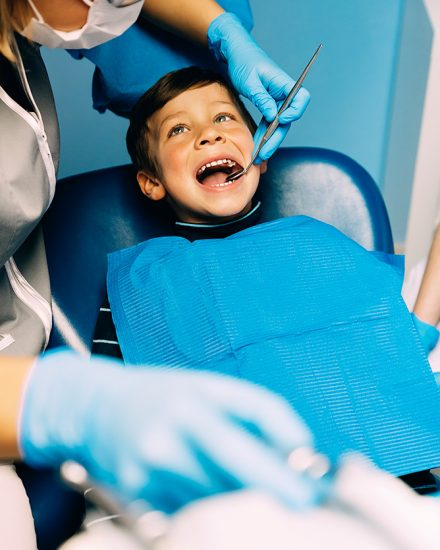 Child in dentist chair for a routine check up.